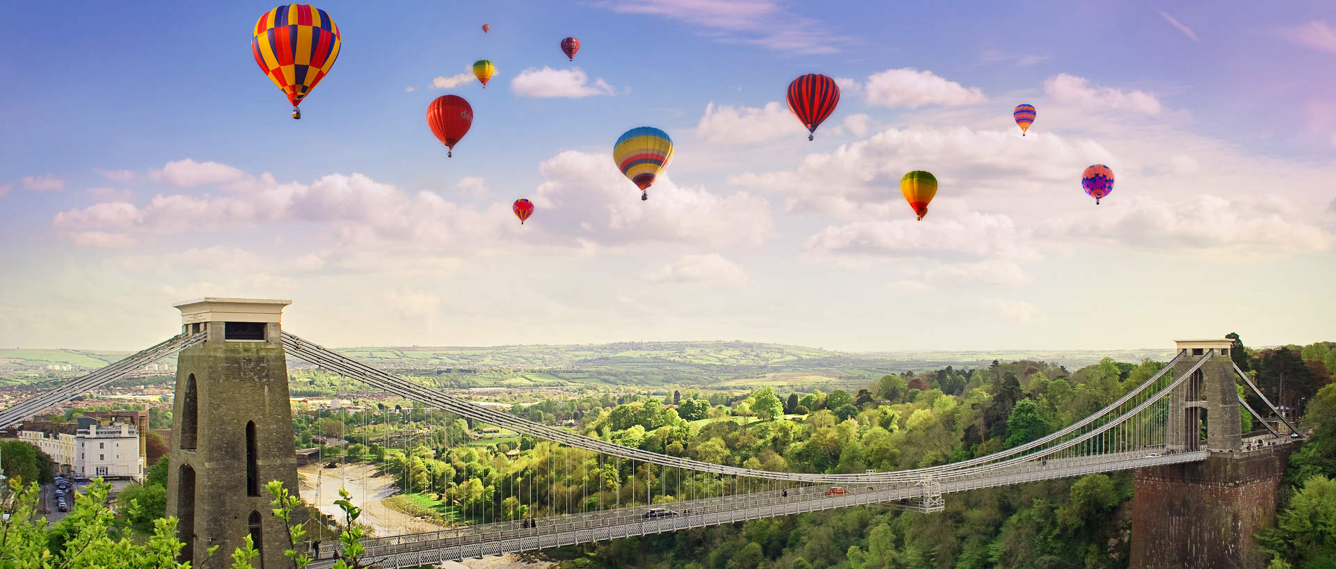 Hot air balloons flying over the Clifton Suspension Bridge